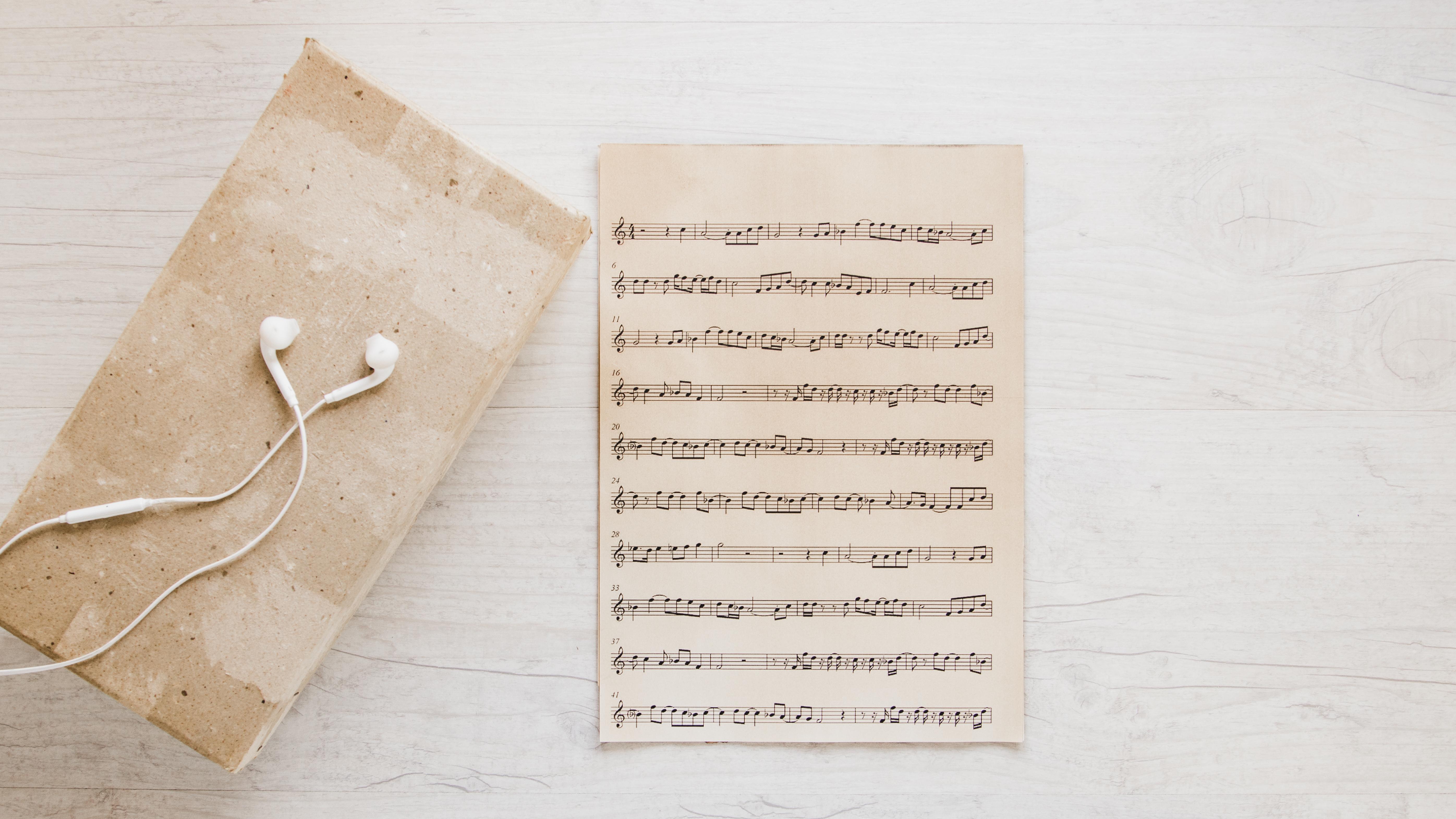 earphones-near-old-sheet-music
