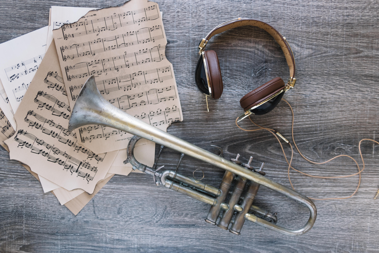 headphones-near-trumpet-sheet-music